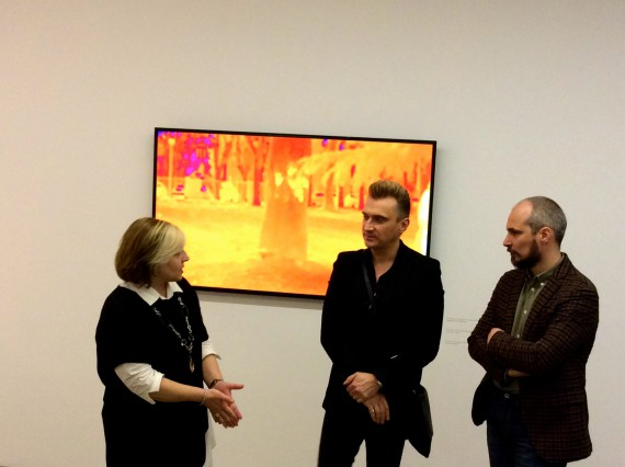 """Cagol discussing """"The Body of Energy"""" with the Civica curators in a press preview."""